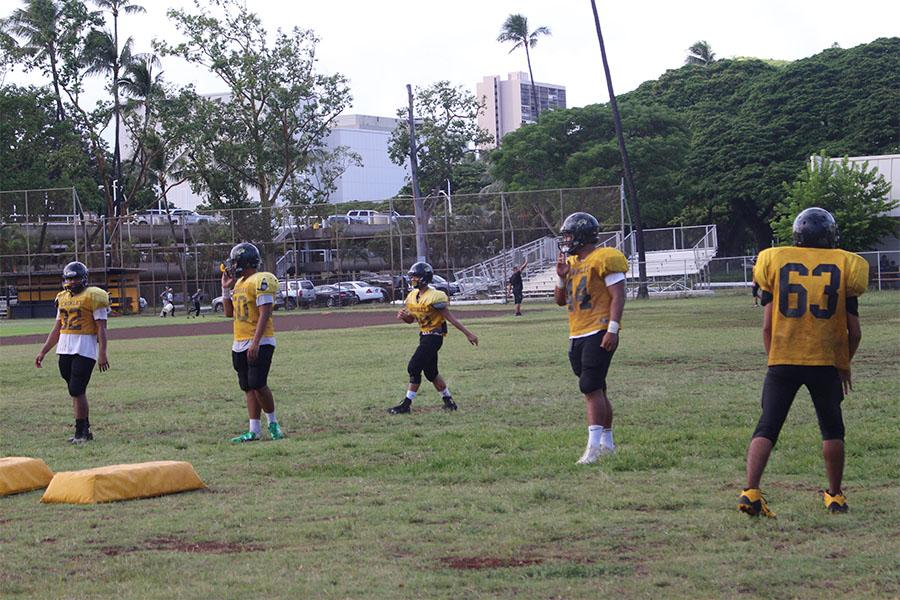 JV football team practices for the Waipahu game. The Tigers lost 43-6. Alexandria Buchanan threw the ball to Keanu Pimental and he bombed the ball to Sinapati Pita and they got the touchdown.