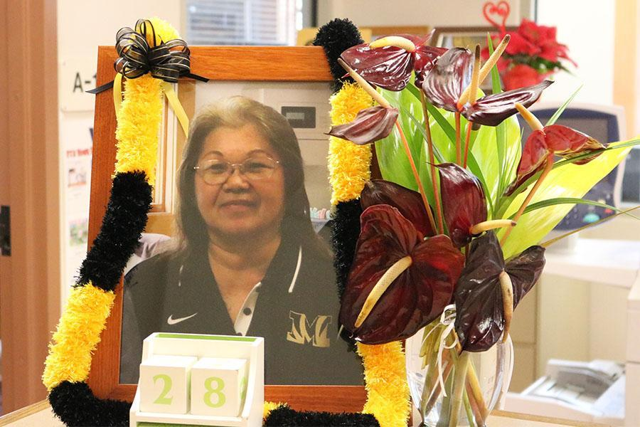 A portrait of Jeannie Kurihara from the memorial is in the main office.