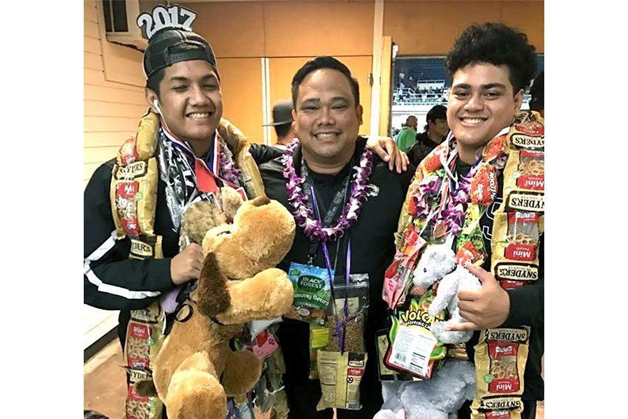 Wrestlers+Laulii+Iosefa+and+Ezekiel+Samuelu+with+assistant+coach+Imialoa%E2%80%99a+Richardson.+Photo+contributed+by+Shanel+Samuelu.