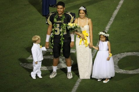 Homecoming King and Queen with the crown barer and flower girl.