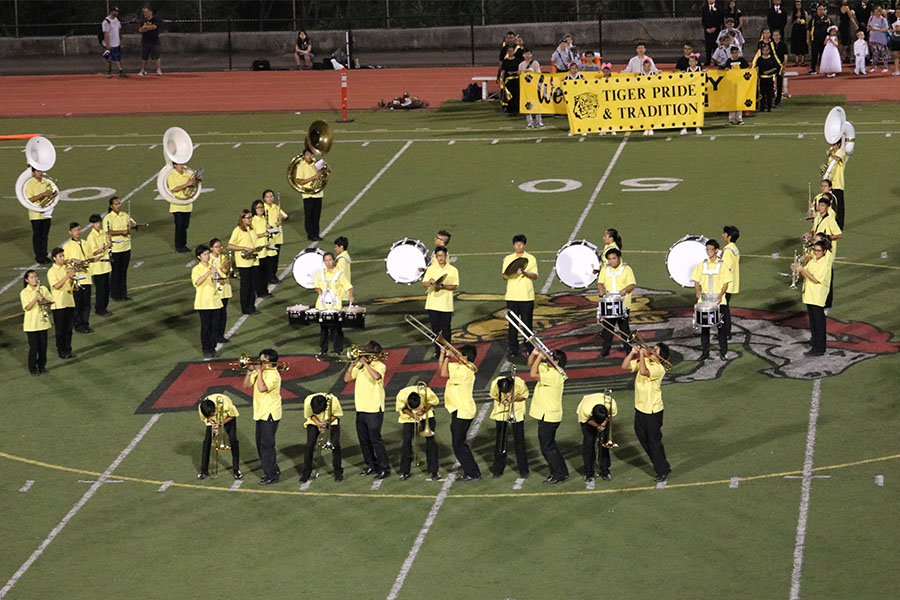 The+MHS+Band%27s+trombone+section+perform+a+special+routine+at+the+game.