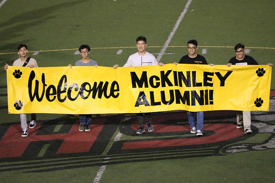 Alumni+from+previous+graduating+classes+welcome+the+other+MHS+alumni+that+were+present+at+the+game.