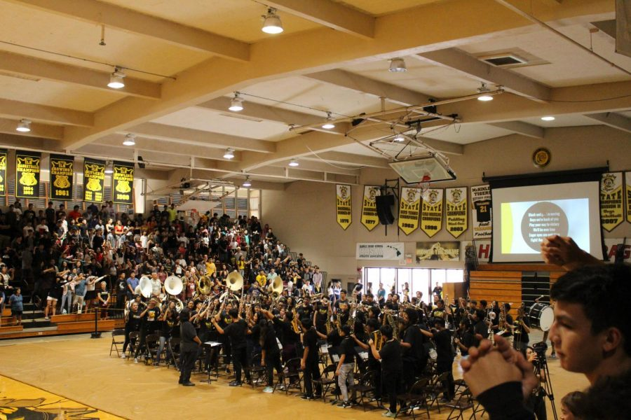 The band sings along with the school to Black and Gold at the end of the assembly. photo by Kevin Arroyo