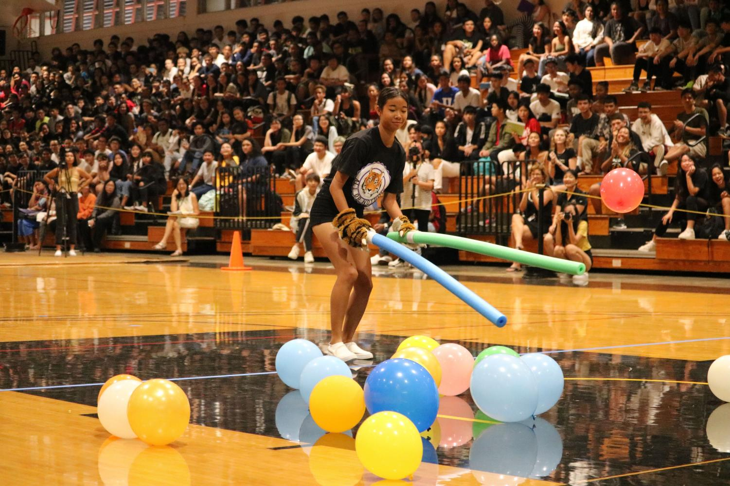This+%22simple+game%22+required+students+and+teachers+to+carry+balloons+using+pool+noodles%2C+but+there+was+a+slight+twist+added.+Each+participant+had+to+wear+a+part+of+the+Tiger+Mascot.+Here%2C+the+Seniors+representative+is+wearing+the+paws.%0Aphoto+by+Sabrina+Williams
