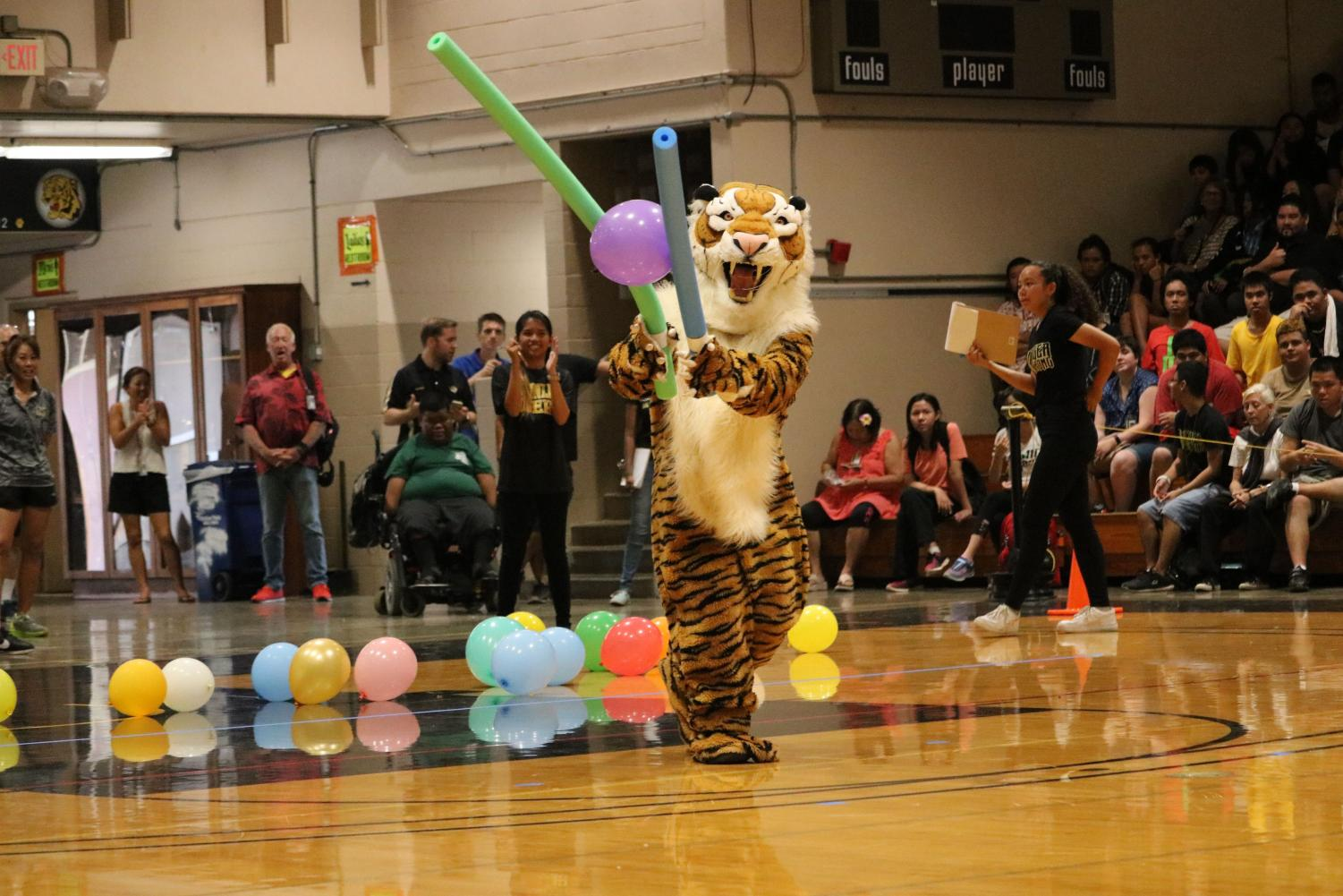 MHS+teachers%2C+Mr.+Kamida+got+the+pleasure+of+wearing+the+entire+tiger+mascot+during+the+game.+%0Aphoto+by+Sabrina+Williams