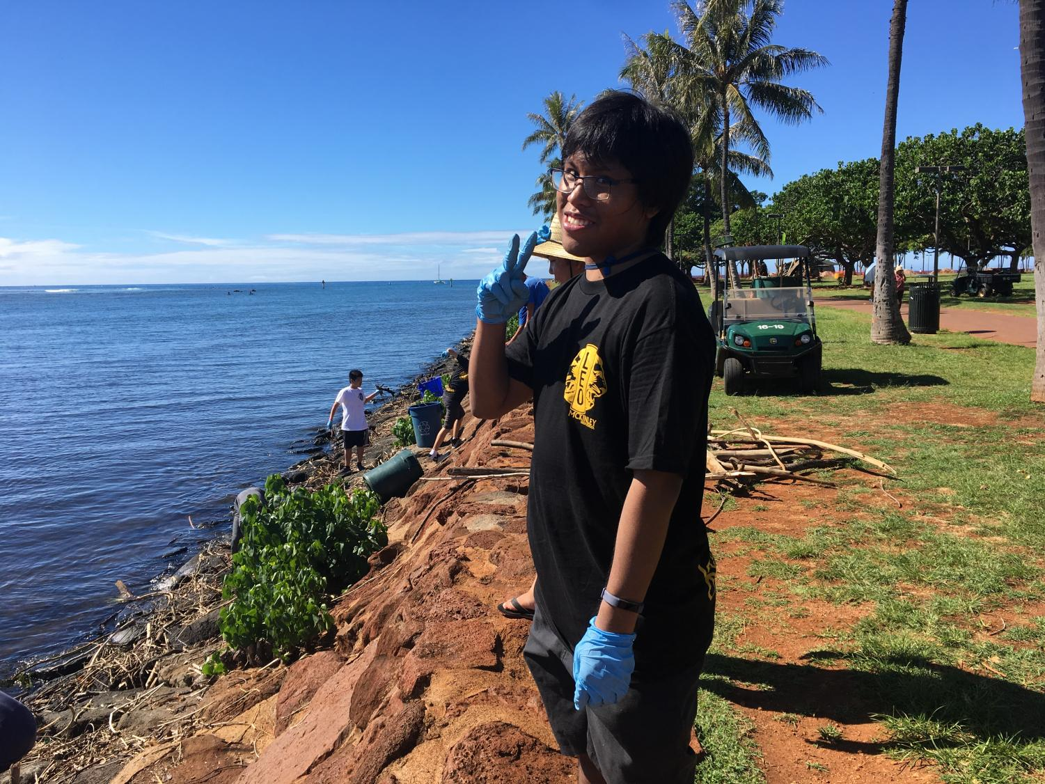 Jason Yadao, the adviser for LEO Club, supervised his students at a beach clean up at Ala Moana Beach Park.