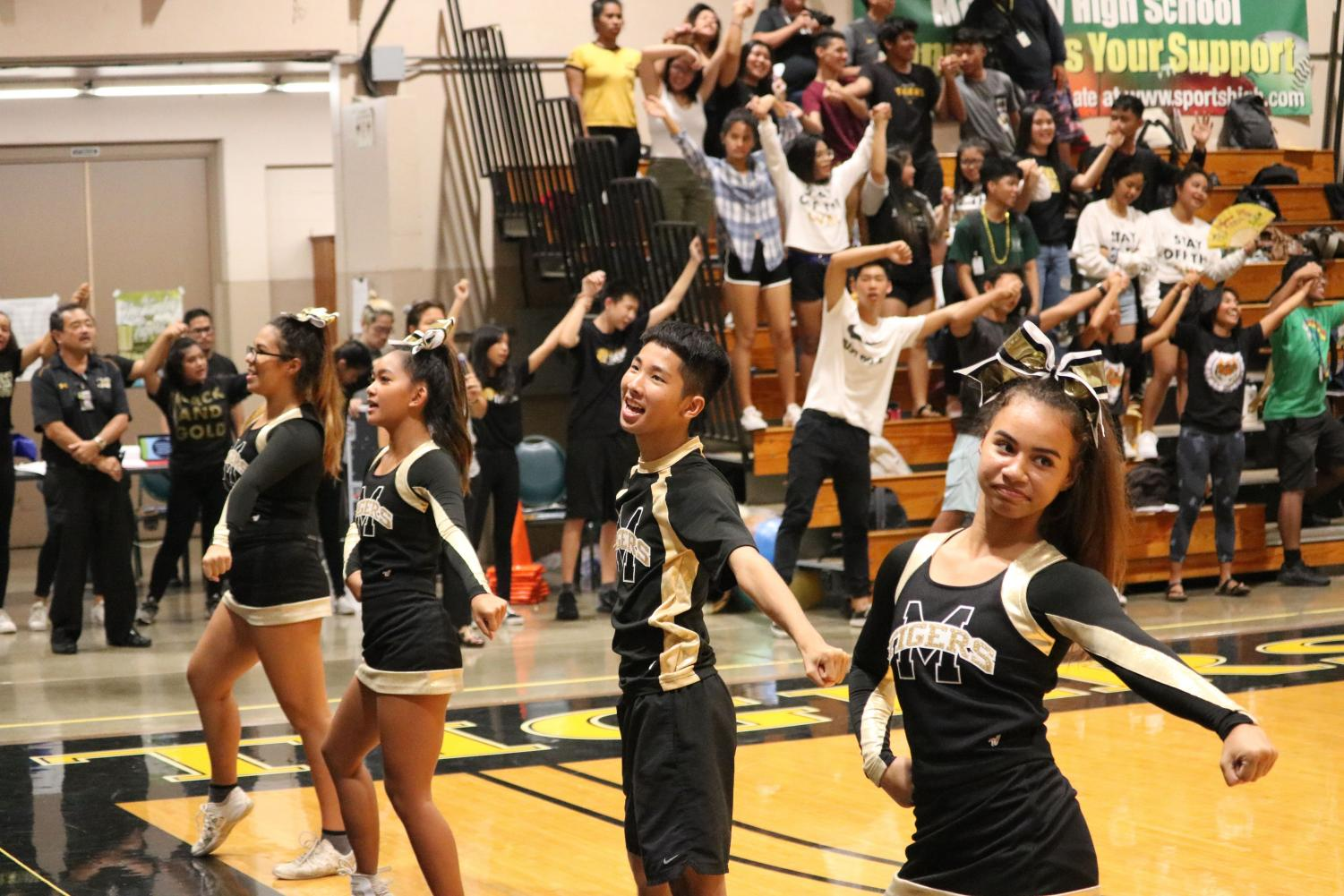 The cheerleaders lead the students in Black and Gold with their routine at one of the assemblies this year.