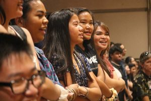 McKinley students join hands during the singing of our alma mater at the end of the assembly.