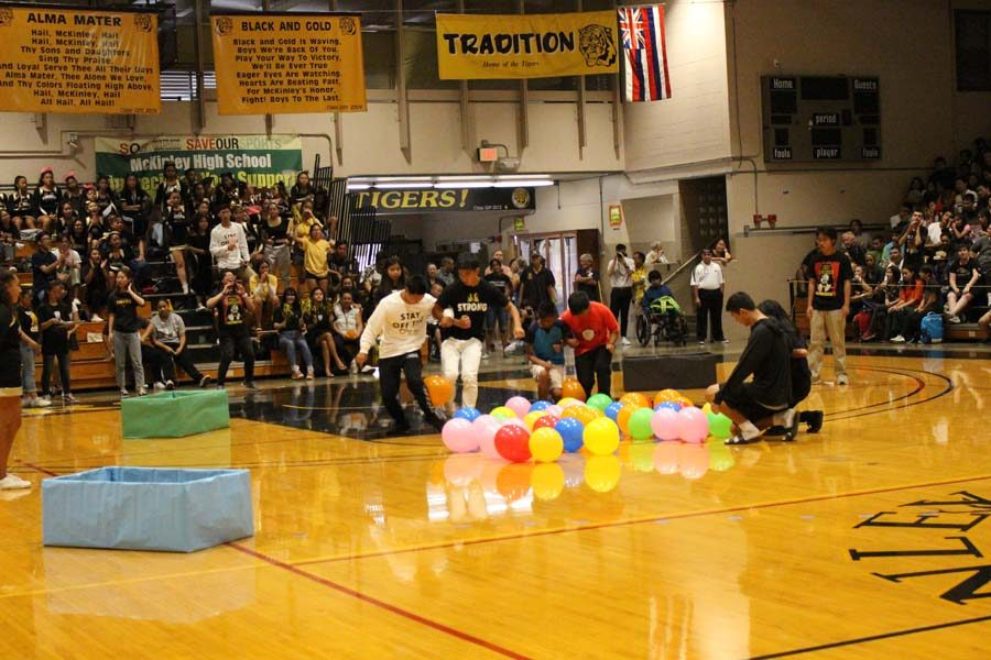 Participants were challenged to work with their partner to get balloons into their corresponding bins without their hands.