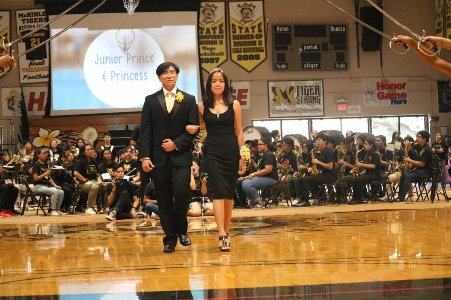 This year's Junior Prince Bach Bui escorts Princess Michelle Pham down the gym.