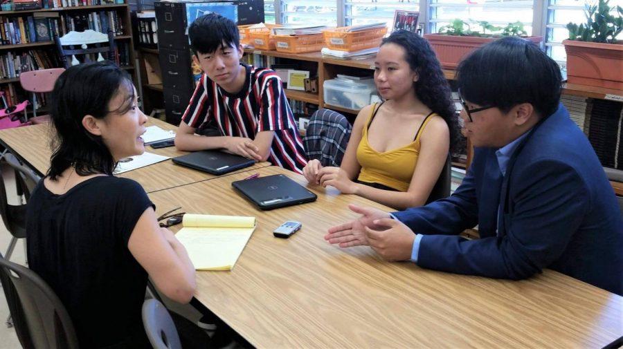 Pinion editors from the 2019 staff, Kelvin Ku, Alexandria Buchanan, and Thompson Wong interview a Civil Beat reporter.