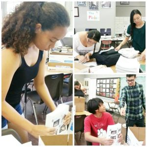 Pinion staffers from 2017 bundle copies of the paper to give out to students and staff.
