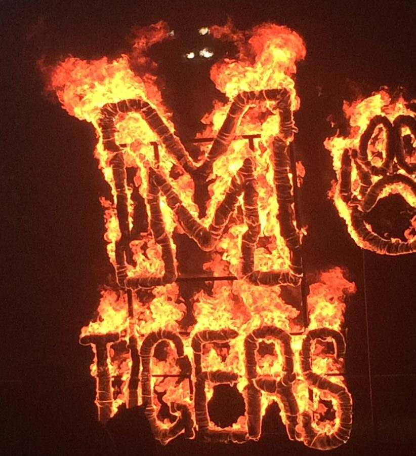 Traditional Lighting of the M burns brightly in the night after all the entertainment and events.