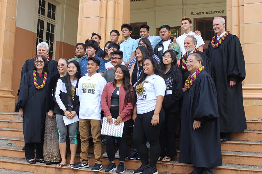 Supreme Court Justices  take a group photo with MHS students.