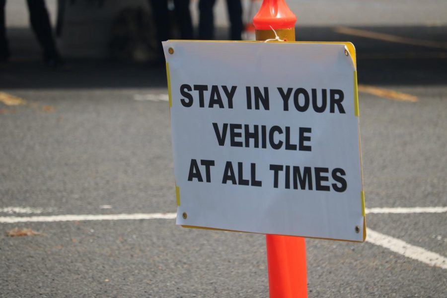 This sign reminds guests of the rules. Guest could only leave the vehicle for a group photo after the graduate crossed the oval.