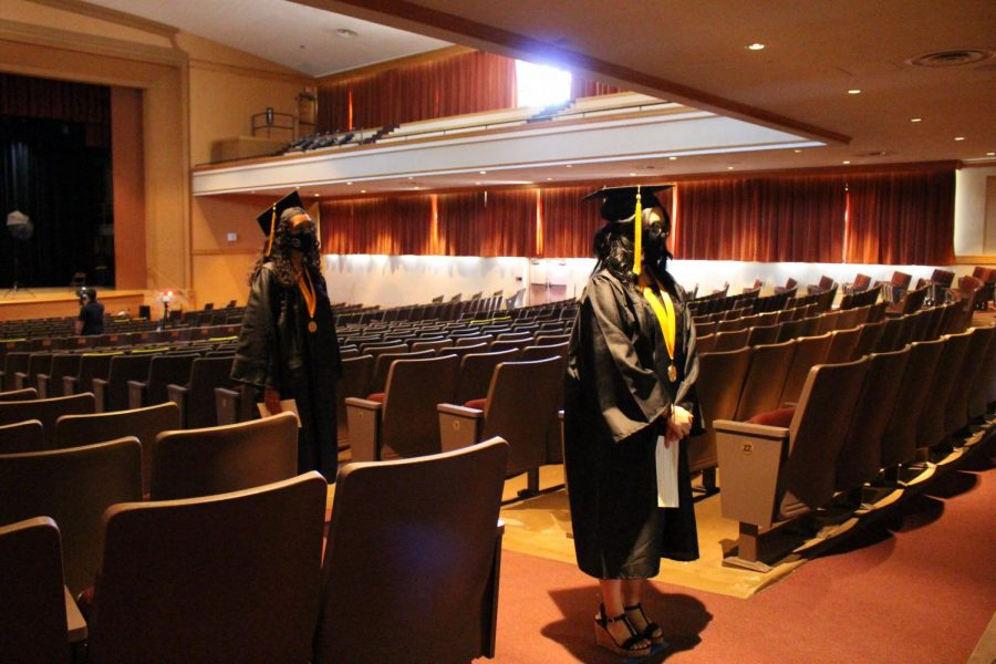 Seniors wait in the auditorium after receiving their medallion.
