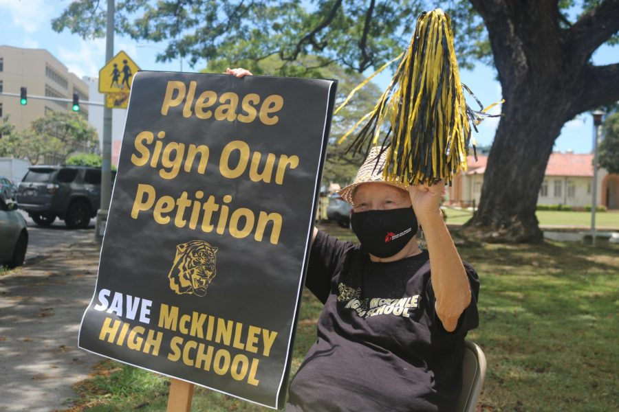 McKinley High School Alumni Association member and 1951 graduate Helen Rauer sits in front of the school to raise awareness about the Save McKinley High School campaign